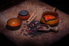 Flower and cinnamon tea prepared for brewing. Flower and cinnamon flavored tea prepared for brewing on wooden board Royalty Free Stock Photos