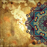 Flower circle design on gold grunge background Stock Images