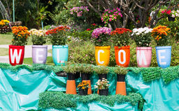 Flower clay pot. And painting that welcome message in the garden Stock Images