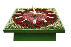 Flower clock with a dial with arrows. On a white background Stock Image