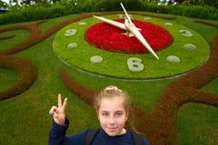 Flower clock garden in Geneve tourist girl Geneva. Switzerland Swiss Stock Photo