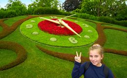 Flower clock garden in Geneve tourist girl Geneva. Switzerland Swiss Royalty Free Stock Images