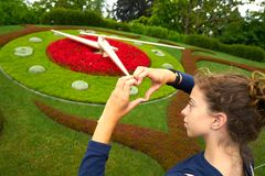 Flower clock garden in Geneve tourist girl Geneva. Switzerland Swiss Stock Image