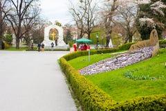 Flower clock and Statue of Johann Strauss,  Stadtpark, Vienna, Austria Stock Photography