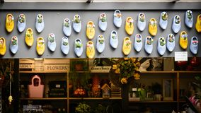 Flower and clogs shop in Bloemenmarkt, Amsterdam Netherlands. March 2015. stock image