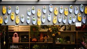 Flower and clogs shop in Bloemenmarkt, Amsterdam Netherlands. March 2015. Landscape format stock image