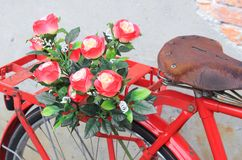 Flower  close up on saddle red bicycle classic vintage Stock Photo
