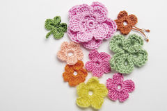 Flower and clover leaf made of yarn Stock Photos