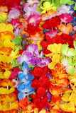 Flower collars. Detail of coloured plastic flowers collar Royalty Free Stock Images