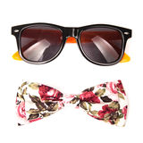 Flower colors bow tie and fashionable sunglasses isolated. On white background Stock Photos