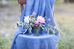 Flower composition on the chair decorated with texstile Stock Photo