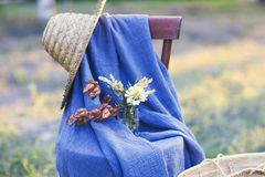 Flower composition on the chair decorated with texstile Royalty Free Stock Photos