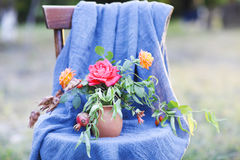 Flower composition on the chair decorated with texstile Stock Photography