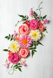 Flower composition. Festive flower composition on the white wooden background. Overhead view Stock Photography