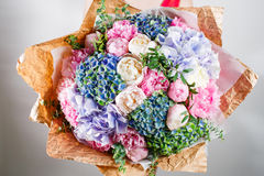 Flower composition with hydrangea and peonies. Color pink, green, lavander, blue. Kraft paper. crisp packaging Royalty Free Stock Images