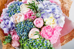 Flower composition with hydrangea and peonies. Color pink, green, lavander, blue. Kraft paper. crisp packaging Stock Photos