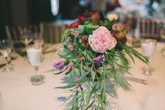 Flower composition on a wedding table. Nice flower composition on a wedding table Stock Photo