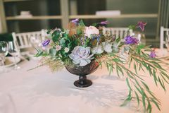 Flower composition on a wedding table. Nice flower composition on a wedding table Royalty Free Stock Photos