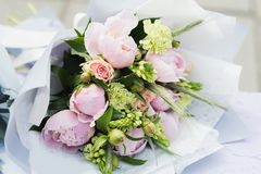 Flower composition with white and pink roses and other flowers. Bridal bouquet with creamy roses and peonies. Farewell Bell. day of knowledge. beginning of the royalty free stock photo