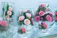 Flower compositions of roses in vacuum glass stock photography