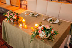Flower compositions on the wedding table in rustic style. Wedding decorations with their own hands. Stock Photos