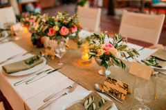 Flower compositions on the wedding table in rustic style. Wedding decorations with their own hands. Stock Image