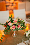 Flower compositions on the wedding table in rustic style. Wedding decorations with their own hands. Stock Photography