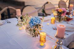 Flower compositions on the wedding table in rustic style. Wedding decorations with their own hands. Royalty Free Stock Photos