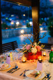 Flower compositions on the wedding table in rustic style. Wedding decorations with their own hands. Stock Photo
