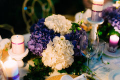 Flower compositions on the wedding table in rustic style. Wedding decorations with their own hands. Royalty Free Stock Photography
