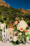 Flower compositions on the wedding table in rustic style. Wedding decorations with their own hands. Stock Images