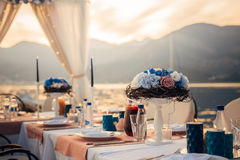 Flower compositions on the wedding table by the sea Stock Image