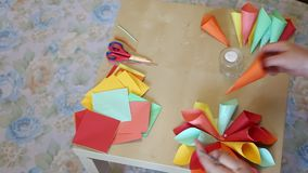 Flower cones of colored paper. Making paper cones colorful shaped flower stock video