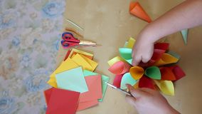 Flower cones of colored paper. Making paper cones colorful shaped flower stock footage
