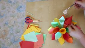 Flower cones of colored paper. Making paper cones colorful shaped flower stock video footage