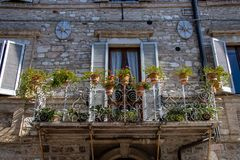 The Enchanting Streets of Asssi. A flower covered balcony along the enchanting streets of Assisi, Italy stock photos