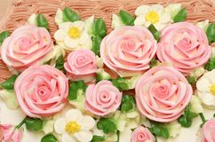Flower cream on top of beatiful cake Royalty Free Stock Photo