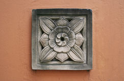 Flower crest plaster. On the old wall Royalty Free Stock Image