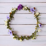 Flower crown on a wooden background. Flower crown on a  white painted wooden floor Royalty Free Stock Photos