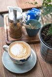 A flower cup of hot coffee Royalty Free Stock Photo