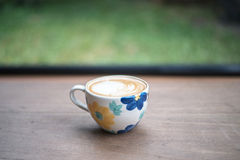 A flower cup of hot coffee Royalty Free Stock Photography