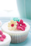 Flower cupcake. Colorful flower cupcake on a plate Stock Photos
