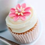 Flower cupcake. Cupcake decorated with a pink sugar flower Royalty Free Stock Photography