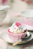 Flower cupcake. Afternoon tea served with a flower cupcake Royalty Free Stock Photos