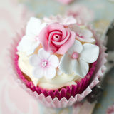 Flower cupcake. Cupcake decorated with fondant flowers Royalty Free Stock Images
