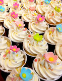 Flower cupcake. Cupcake decorated with pink fondant flowers Stock Photo
