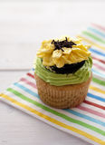 Flower cupcake. On a wooden table Royalty Free Stock Photo