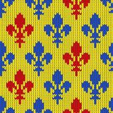 Knitted woolen pattern with blue and red lilies on a yellow. Flower-de-luce on a seamless vector woolen pattern. Knitted woolen pattern with Heraldic lilies Stock Photography