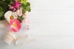 Flower decor on wooden background Stock Photos