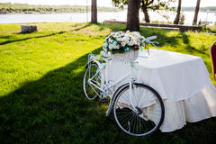 Flower decorated bicycle at wedding registration ceremony.  Royalty Free Stock Photo